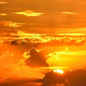 photo of bright yellow and orange sunrise