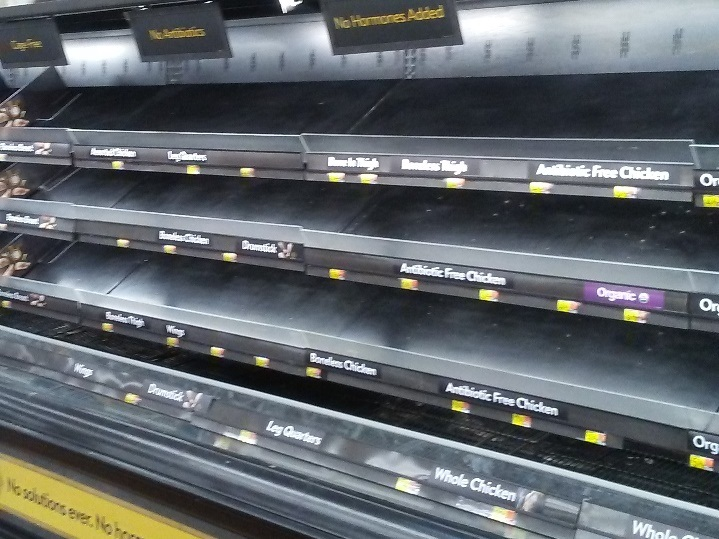 A row of empty grocery shelves during the winter storm in Texas.